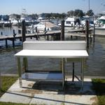 "The fish cleaning station is located just off to the right of Pier #2.  The club has conveniently positioned the station so that other members cannot actually see the size of the fish caught...thereby limiting ""fish tales"" only to your imagination."